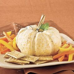 """The Great White Pumpkin Cheese Ball   Give a subtle nod to the Halloween classic """"It's the Great Pumpkin, Charlie Brown"""" and serve this sharp-cheddar cheese ball with a pepper kick."""