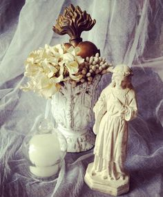 French saint, flaming heart relic and Astier de Villatte vase.