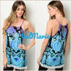 Elegant Aqua & Purple Tunic with Lace Hem MADE IN USA this elegant lightweight beautiful thin strap tunic is sure to turn heads!!! A gorgeous Aqua, purple and black print with an adorable white lace hem. Made of 95% polyester, 5% spandex. Have S (2-4) M (6-8) and L (10-12) you may purchase this listing as I've created individual listings for each size. Limited quantities, get one quick! Perfect for Spring! ValMarie Boutique Tops Tunics