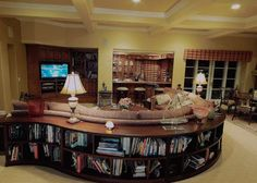 Large curved sofa with a bookcase behind it Living Room Bookcase, Home Living Room, Living Room Decor, Living Room Inspiration, Home Decor Inspiration, Design Inspiration, Circular Couch, Curved Sectional, Sectional Sofa