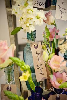 vintage vases that double as escort cards and centerpieces