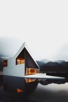 I love the sharp contrast between the pure white of the man-crafted building and the sculpted by nature mountains in the background.The building also has the appearance of floating.