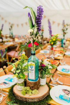 Think about applying colourful gin bottles filled up with wild flowers for centrepieces for the excitement festival-style wedding party. Emma B Picture taking Table Decoration Wedding, Wedding Table Themes, Wedding Table Centerpieces, Centrepieces, Centerpiece Ideas, Table Centre Pieces Wedding, Wood Slice Centerpiece, Used Wedding Decor, Wood Themed Wedding