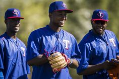 Texas Rangers infielder Jurickson Profar laughs with Hanser Alberto (right) and Pedro Ciraco while participating in a fielding drill during a spring training workout at the team's training facility on Friday, Feb. 26, 2016, in Surprise, Ariz. (Smiley N. Pool/The Dallas Morning News)