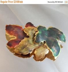 This #vintage three leaf brooch is absolutely stunning!  It features a large trio of gold tone leaves, covered with enamel, one dark green, one moss green and one rust red, ... #ecochic #etsy #jewelry #jewellery #holiday2014etfs