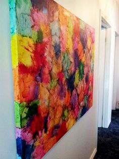 A beautiful piece of melted crayon art.  (Artist Unknown).  See?  There's no reason to ever outgrow your crayons!