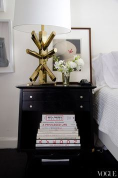 WSH <3 the black nightstand mixed with a sculptural gold lamp.