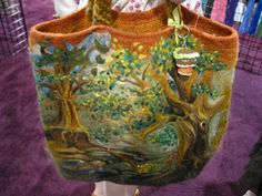 This needlefelted bag was so amazing, it made me want to cry. The artist, Tracy Clark, was featured in a Savannah Morning News article — interesting stuff! I would have bought it straight off her arm if it hadn't already been spoken for, it was that great. Here's Tracy in the South West Trading Company booth.