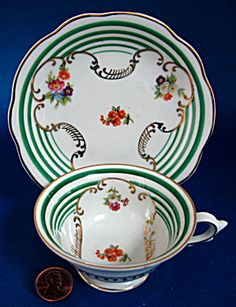 US Zone Cup And Saucer Green Stripes Gold Floral Swags. Click on the image for more information.