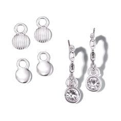 Shiny silvertone open hoop earrings with interchangeable charms: 1 pair round discs in shiny finish, 1 pair of round discs in a textured finish, and one pair of drops with bezel set round CZs. Regularly $16.99, buy Avon Jewelry online http://eseagren.avonrepresentative.com