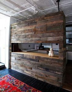 reclaimed wood wall - I think I'd like to do this in a weird corner where our TV hangs.  It's a boring wall because there's no room for art with the TV bracket, and the cords show running up the wall, too.  This could be a good way to spice it up and hide all that.