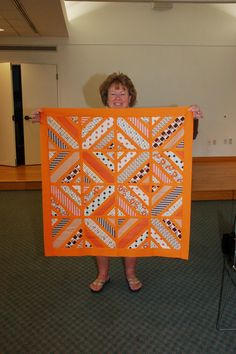 Terrie Langer's Inspiration for the Hadley Challenge Terrie with her quilt top at the July meeting. Bargello Quilts, Scrappy Quilts, Baby Quilts, Bright Quilts, Purple Quilts, Quilting Projects, Quilting Designs, Quilting Ideas, Orange Quilt