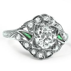 The Yuina Ring from Brilliant Earth: This breathtaking and distinctive Art Deco-era ring features a shimmering old European cut diamond accented by two French cut emeralds and twelve twinkling diamond accents, all in an ornate but delicate platinum setting (approx. 1.18 total carat weight).