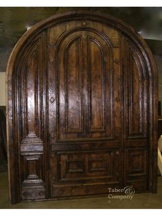 "taberandcompany.com  Mediterranean style door with arch is 8'6"" Wide x 9'6"" Tall and"