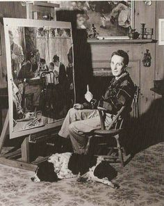 Norman Rockwell in his Arlington, VT studio with study for Saying Grace, 1951