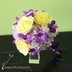 Bridesmaid's bouquet of lavender hydrangea, purple orchids and yellow roses by Beautiful Blooms by Jen.