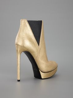 SAINT LAURENT - Ankle boot dourada. 8