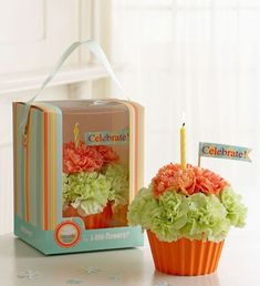 cute flower ideas. dollar store container, mini carns and a few sweetheart roses with candle and mini flag