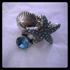 Ocean themed ring Sea star, shell and blue gem ring! Stretchy slip on ring will fit most size fingers. Never worn! Jewelry Rings