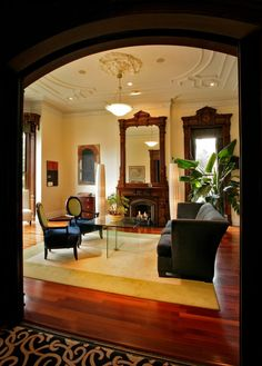 Fireside Salon...view from the entrance hall through the perfectly balanced hand milled black walnut pocket doors