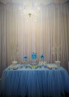 Lovely backdrop and chandelier at a Frozen birthday party!  See more party planning ideas at CatchMyParty.com!