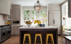 light gray Kitchen cabinets espresso stained kitchen island marble countertops