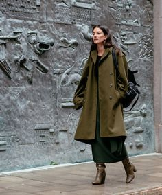 Incredible draping on that coat, and love the long dress underneath.