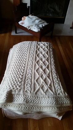 Knitted with double strands of Lion Brand Yarn Fishermen's Wool. I lost count of the number of skeins, but the finished afghan weighs about 11 pounds. Approximately 22-24 skeins.