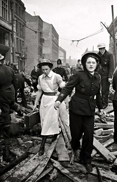 Members of the British Ambulance Corps arrive after a V2 rocket strike on London, 1945.
