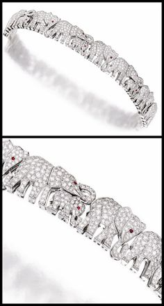Diamond and Ruby 'Elephant' Bracelet, Cartier: Composed of a line of elephant motifs set with brilliant-cut diamonds together weighing approximately 8.50 carats, accented by ruby-set eyes, mounted in platinum, length approximately 170mm, signed and numbered 649705.