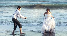 What a cute couple on the beach!! Love splashes!!   #cute #engagement #wedding #photographer #los #angeles