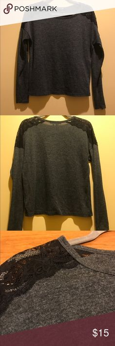 Forever 21 grey with black detail long sleeve Size small Forever 21 grey with black detail on the shoulder long sleeve. Worn but in good condition. (I recycle shipping materials, if you have a problem with that please contact me prior to purchase Forever 21 Tops Tees - Long Sleeve