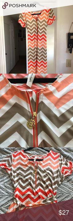 Chevron design summer dress Brand new but no tags. Bright with all the colors of spring with its unique chevron design in tan, white, peach, and bright orange it has a lovely wrap belt and satin feel that flatters the waste . It flows with the wind and is gorgeous 🌺🌺🌺 Tacera Dresses