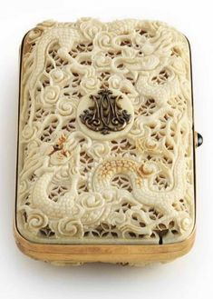"""treasures-and-beauty: """" A Russian jeweled, gold-mounted and ivory cigarette case with rounded corners, the cover and base overlaid with ivory cagework intricately pierced and chased with scrolls and sea-serpents, the cover set with the raised gold. Vintage Cigarette Case, Cigarette Box, Tsar Nicolas Ii, Tsar Nicholas, Vanity Case, Art Nouveau, Faberge Eggs, Antique Boxes, Objet D'art"""