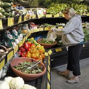 A customer shops for produce at the Hunger Mountain Co-op in April 2013 in Montpelier, Vt. More than a dozen food cooperatives supported the bill that would require the labeling of genetically modified foods.