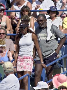 Venus walking with former coach and father Richard Williams