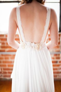 Backless, lace wedding dress | Amy Caroline Photography | see more on: http://burnettsboards.com/2014/08/sparkling-delicate-wedding-dresses/