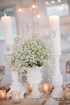Beautiful table! Use baby's breath to go with any white theme and Mirage LED flickering flame candles as your safe light source. Candle Impressions Frosted Glass Holders in white would also look beautiful with this!