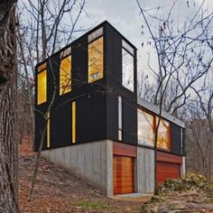 Stacked Cabin --  Milwaukee office Johnsen Schmaling Architects chose a palette of bare concrete, cedar and anodised metal to construct this small family retreat in a remote Wisconsin forest