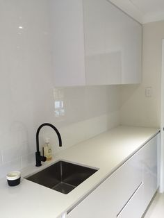 Black matte sink & faucet, white modern kitchen