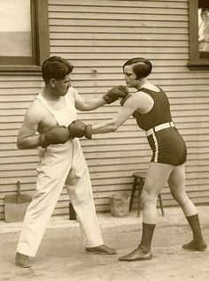 The woman lightweight world champion boxing Louise Adler training with the prize fighter Joe Rivers for the match in which she will defend her title, United States 1926