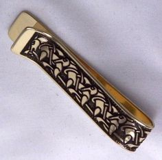 Irish handcrafted Celtic money clip / Celtic tie clip.  The breaking and rejoining of Celtic plaitwork into Celtic knotwork decorates this piece of Celtic jewellery in the manner of the Pictish School of Art. A beautiful Irish gift suitable for men, highlighting Celtic art.  Handmade in Beara, West Cork, Ireland by Aqua Fortress. West Cork, Cork Ireland, Celtic Art, Money Clip, Tie Clip, Irish, Aqua, Jewellery, School