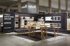 Exhibition graphics designed by Bond for Puustilli's new reductionist kitchen Miinus