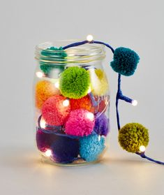 Pom pom galore lights in mason jar easy DIY pompom lights for any event to add some pom pom magic! Kids Crafts, Yarn Crafts, Diy And Crafts, Craft Projects, Arts And Crafts, Diy Crafts For Adults, Christmas Crafts, Christmas Decorations, Pom Pom Decorations