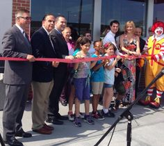Massachusetts politicians (st rep Alan Silva) at ribbon-cuttings with oversize novelty scissors and OH NO LOOK OUT RONALD McDONALD!!!!!