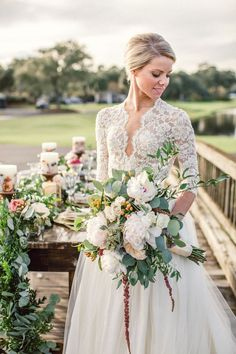 A Charleston winter wedding Styled Shoot by Paula Player Photography. A gorgeous lacy flower topped wedding gown. See more @intimateweddings.com #weddingdress #lace #styledshoot