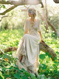 love the eggshell colored, draw string dress & lace...