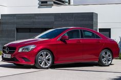 2014 Mercedes-Benz CLA250 side view in red Photo