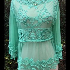 NWOT- Crochet lace women's sm. top Beautiful top, great for casual wear or going to the beach. Armpit to armpit is 19 in neckline to bottom of top is 19 in. Tops Blouses