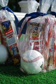 Give traditional treats as baseball party favors.  The good bags contained Cracker Jacks, Twizzlers and a baseball for each guest. by leigh
